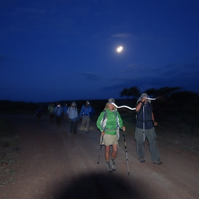 Heat is another of equatorial Africa's realities the Walkers must deal with.  If it gets too hot, night hikes make it more tolerable.  Walks are planned around full moons helping with nocturnal activity.  Marcia Moore and Tim Cahill lead the way in this 2012 night hike. #properwalk #makinduchildrensprogram #dpennellbrooks